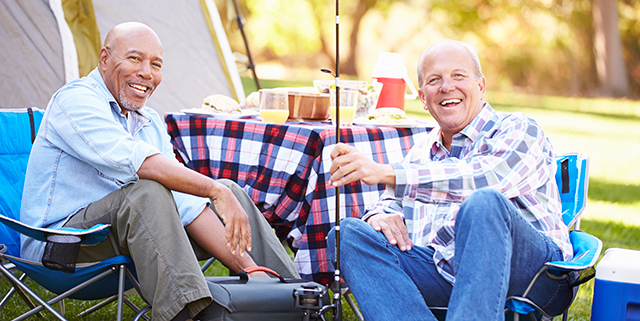 Two older men sitting at a campground